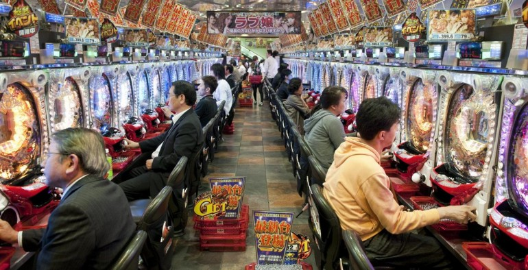 Osaka, Japan, June 1, 2011 Pachinko parlour in Dotombori entertainment district. A pachinko is a popular Japanese gaming device, resembling a vertical pinball machine.  ©Nick Hannes LaPresse Only Italy