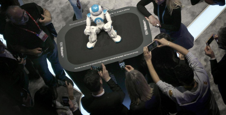 People take pictures of robot Watson at the IBM stand during the Mobile World Congress (MWC) in Barcelona, Spain, on 24 February 2016. The MWC will run from 22 to 25 February 2016. EFE/Alberto Estevez